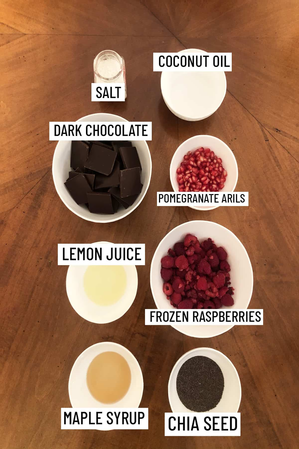 Birds eye view of all ingredients needed to make chocolate cups with chia jam all portioned into individual bowls.