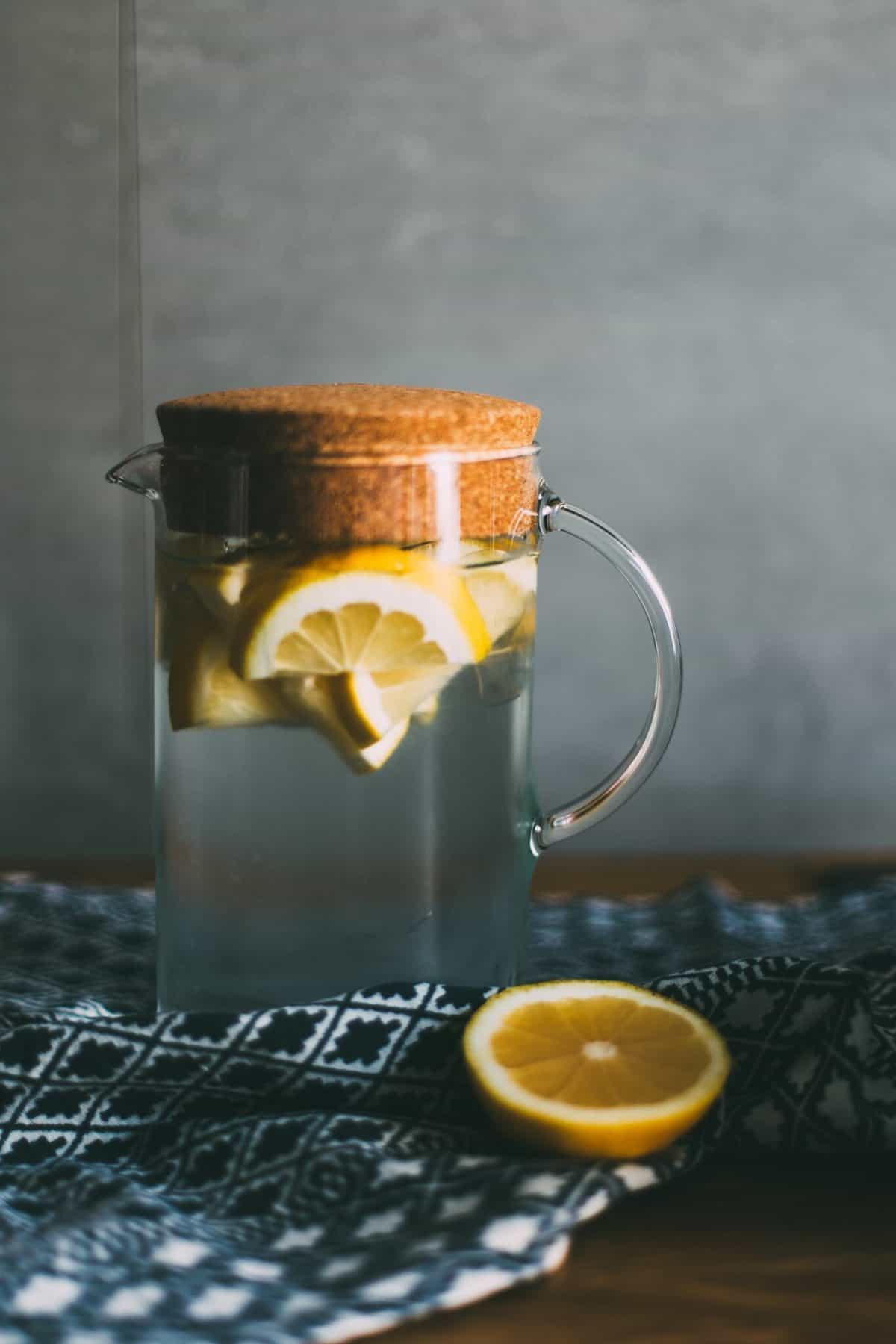 A tall pitcher with citrus wedges.