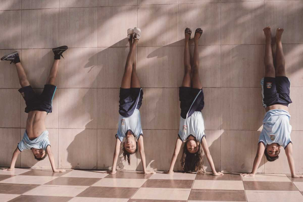 several teens doing gymnastics for weight loss