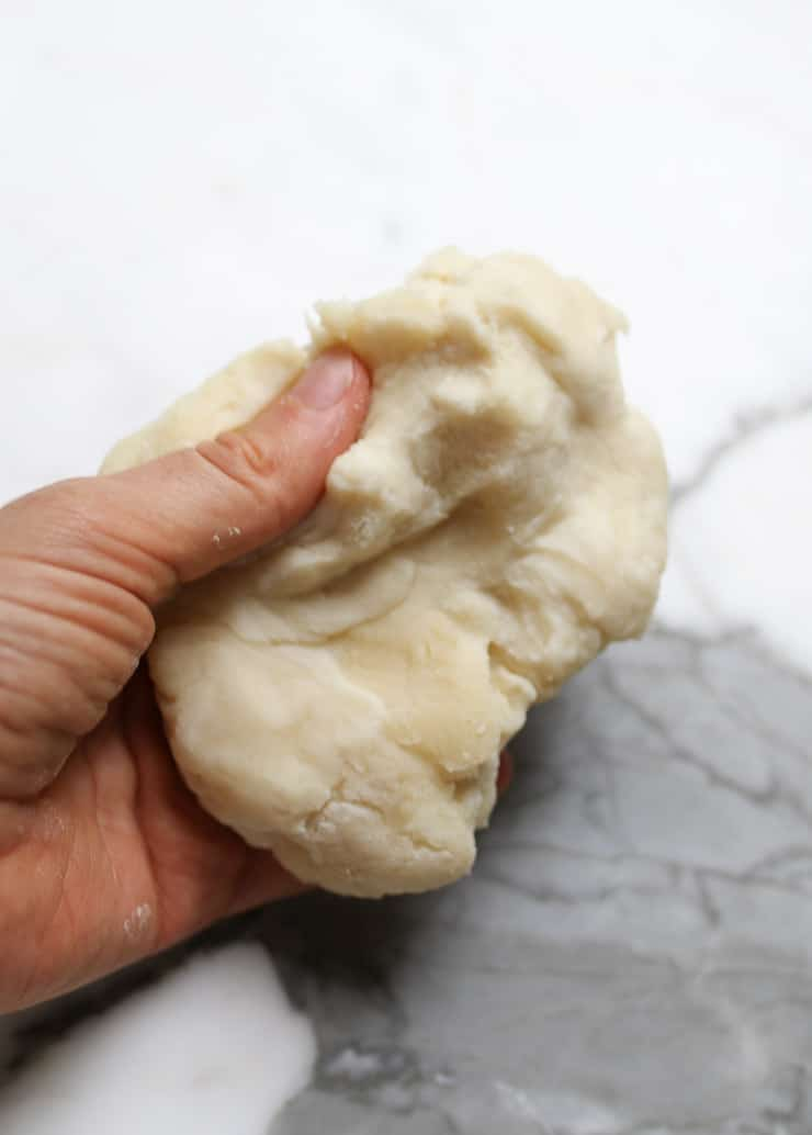 a piece of dough in abbeys hand