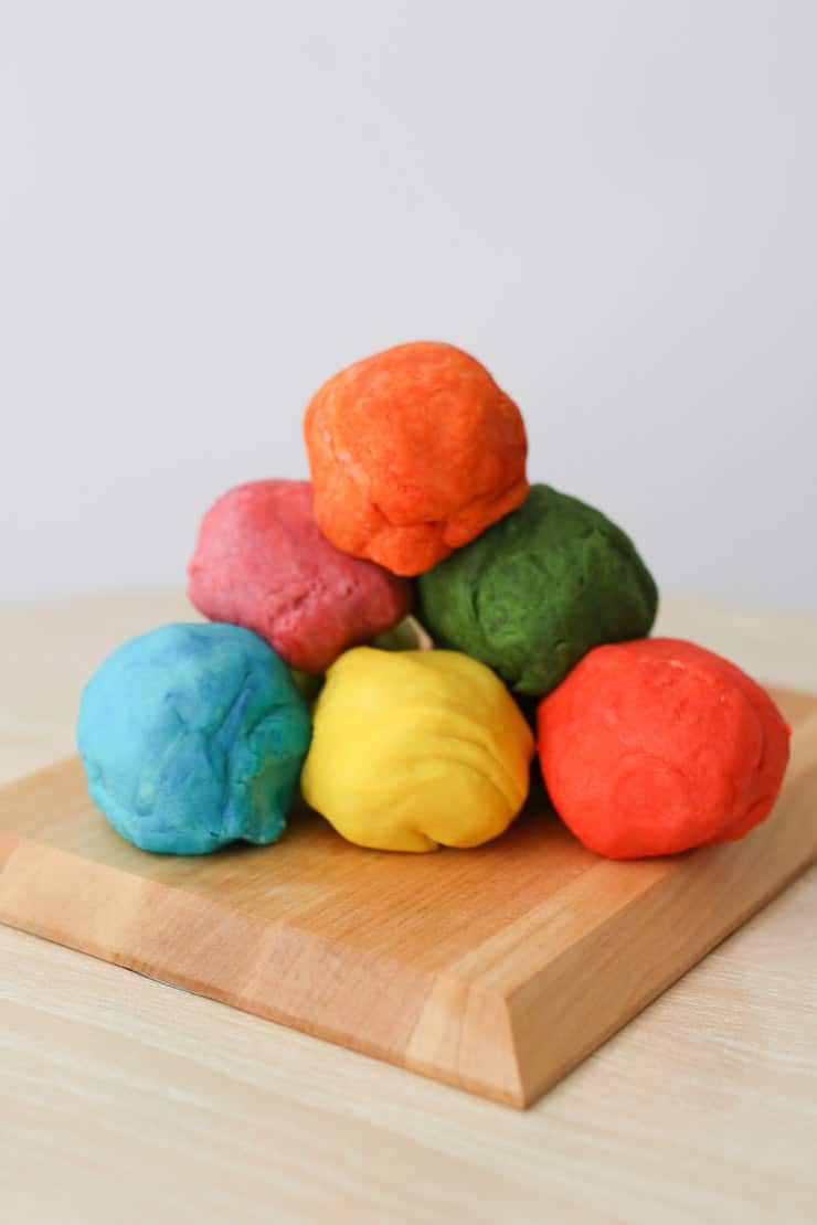 several rolls of homemade play dough stacked on top of one another