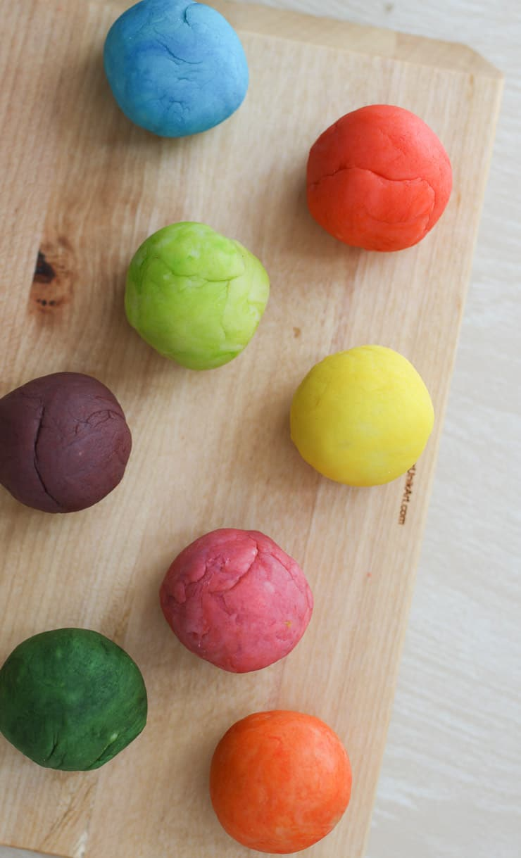 several colourful balls on a wooden board