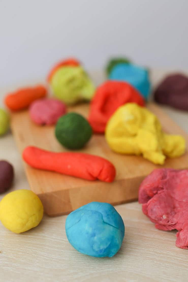 homemade playdough in a variety of different colours and shapes