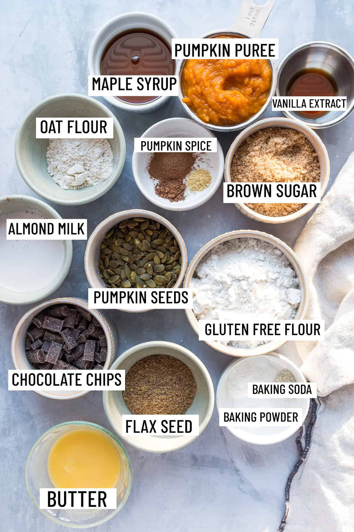 Birds eye view of all ingredients needed to make vegan pumpkin bread portioned into individual bowls and ramekins.