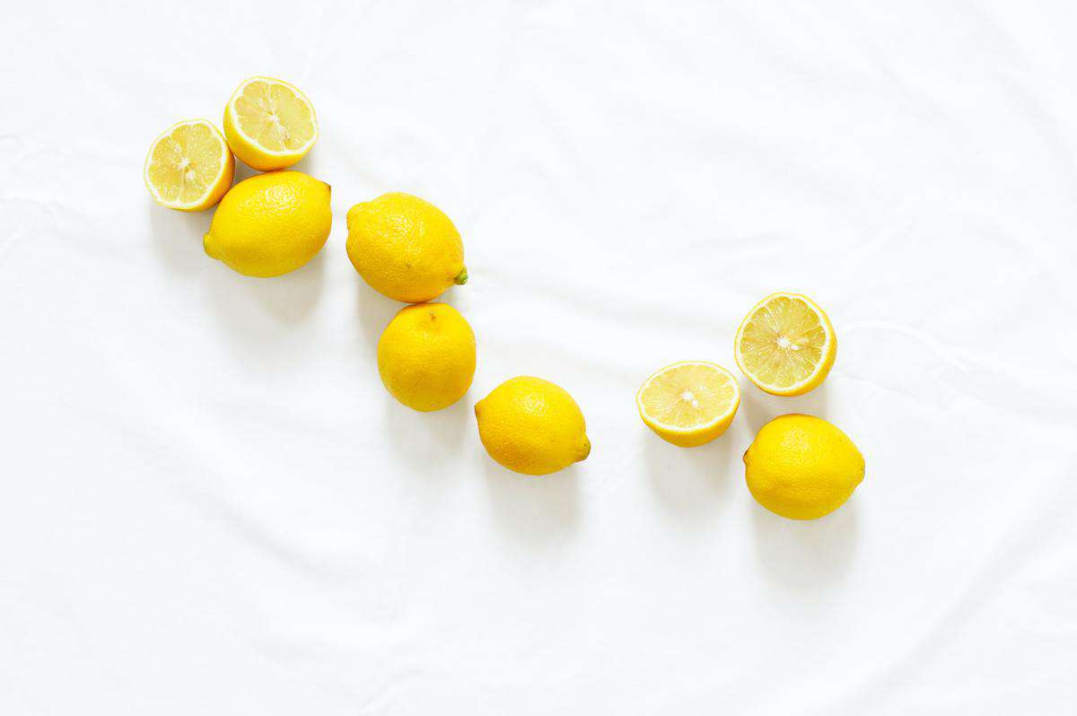 Several lemons with some cut in half.