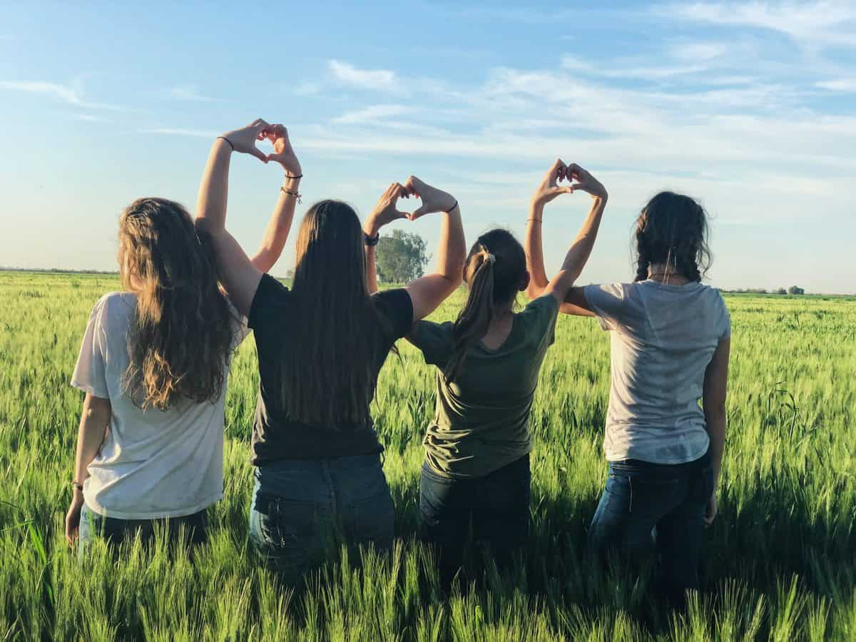 image of several teen girls standing in a field