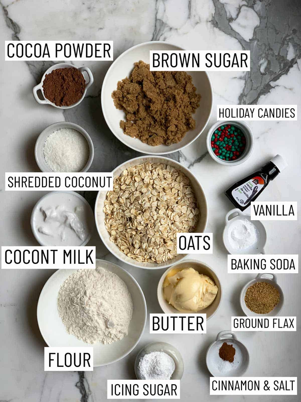 Overhead image of ingredients required to make cookie cups on a marble surface.