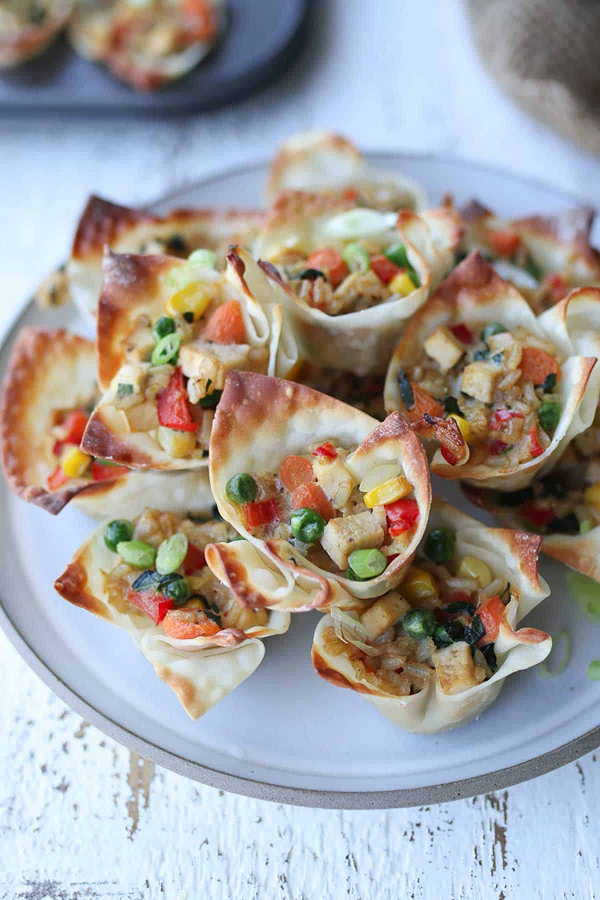 Fried rice cups on a white plate.