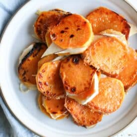 Overheat image of a plate with multiple sweet potatoes grilled cheese bites on a white plate.