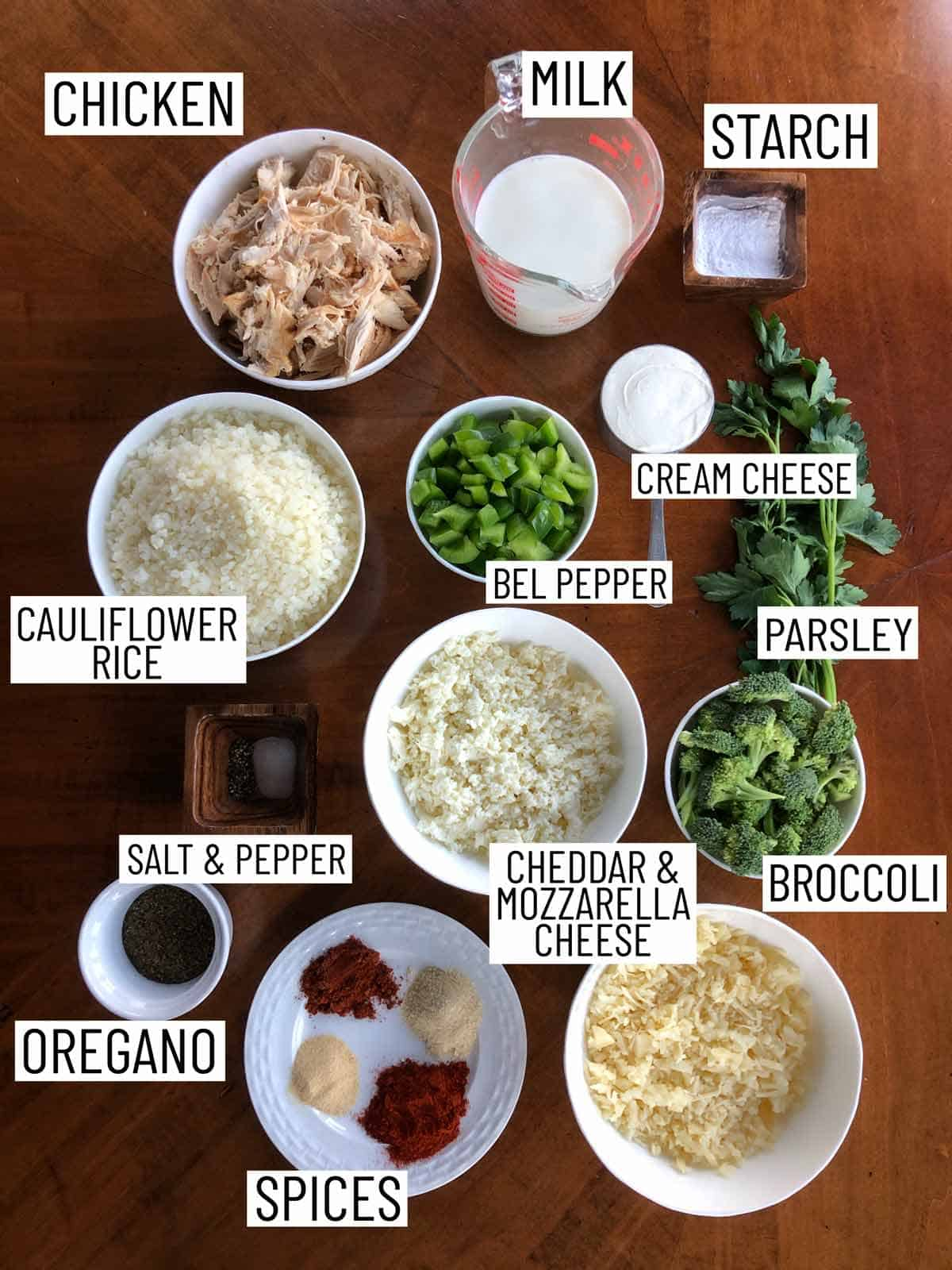 Overhead image of ingredients requires to make a cauliflower rice casserole.