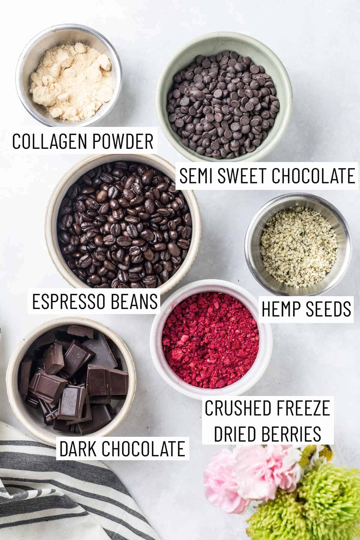 Ingredients for making homemade chocolate covered espresso beans as well as bowls of topping options.