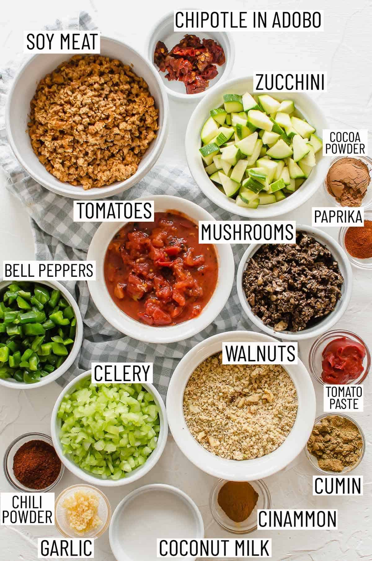 Overhead image of the ingredients required to make a no bean chili laid out in bowls.
