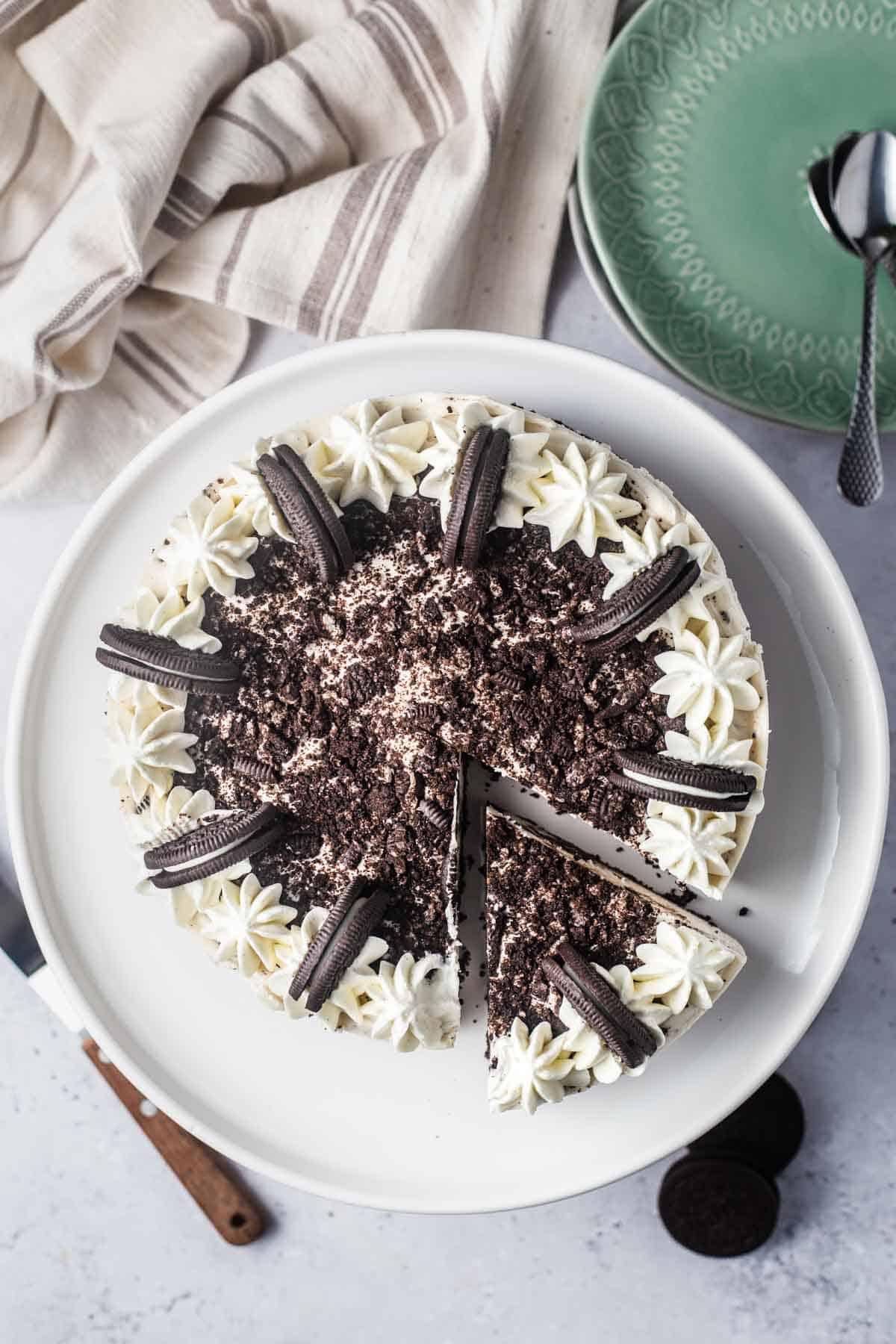 Birds eye view of vegan Oreo cheesecake on a white plate.