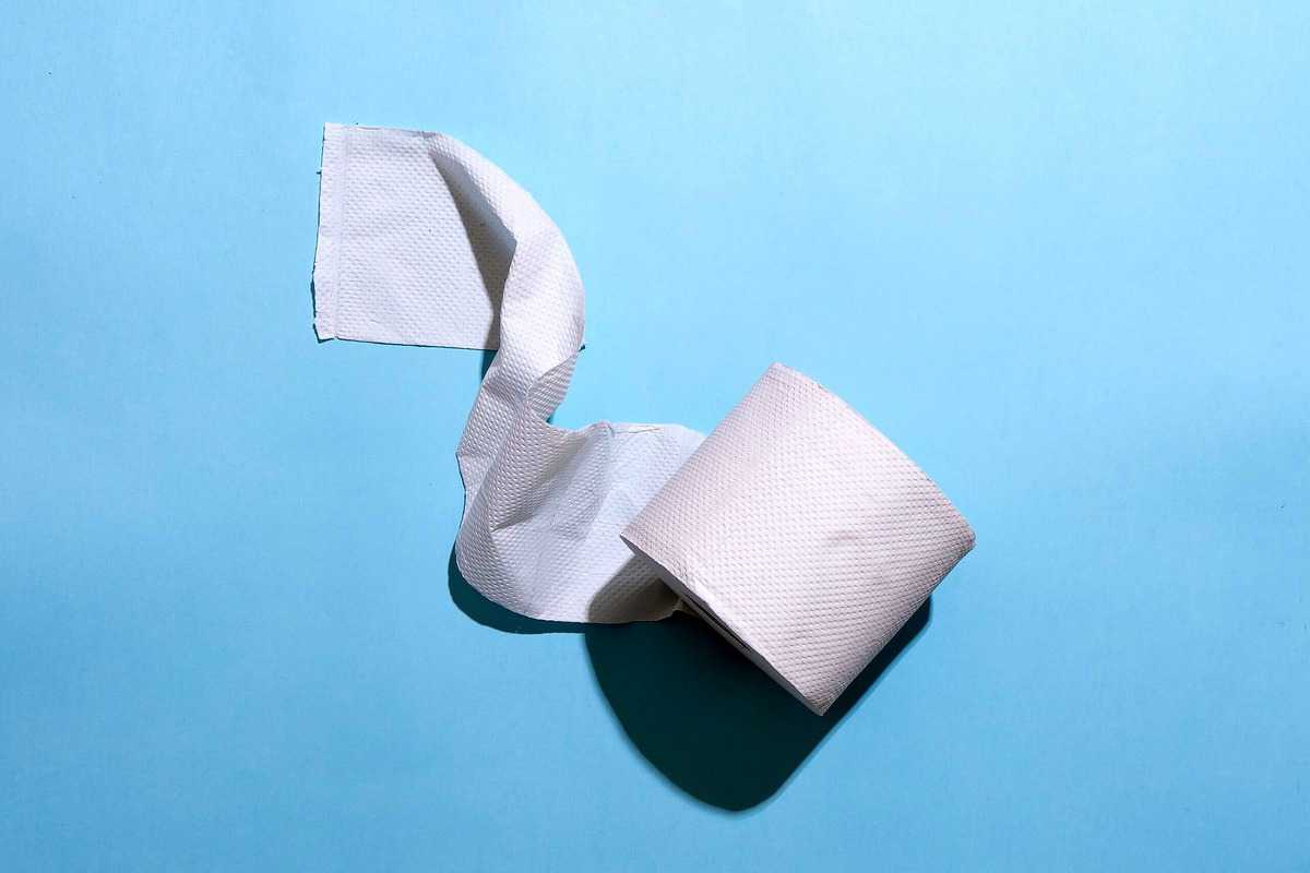 Image of a roll of toilet paper against a blue background.