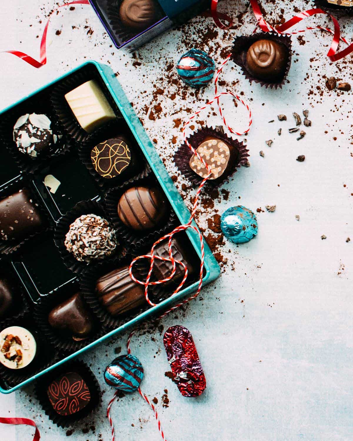 A large box of chocolates representing food cravings during period.