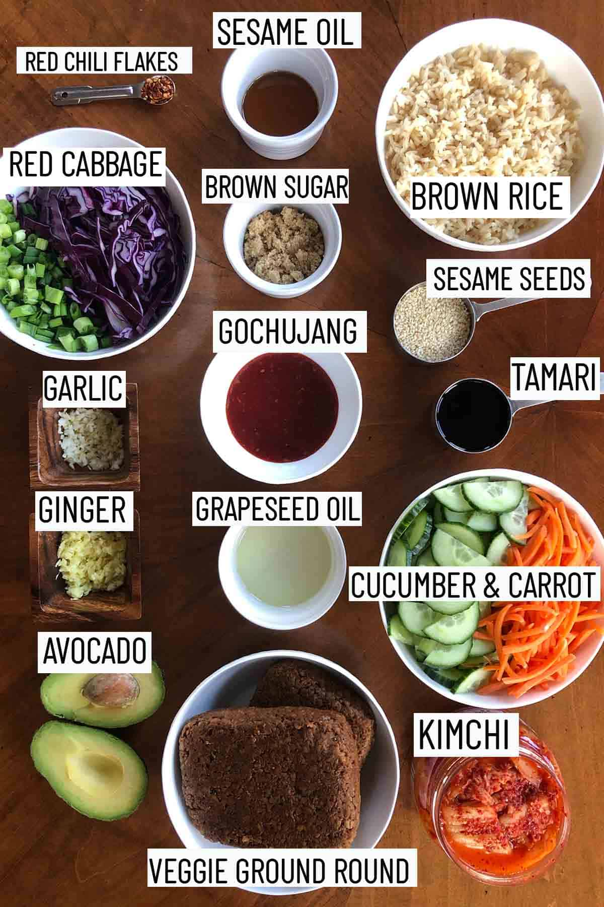 Flat lay image of portioned ingredients for recipe including the vegetable toppings, ingredients for the sauce, and the veggie meat.