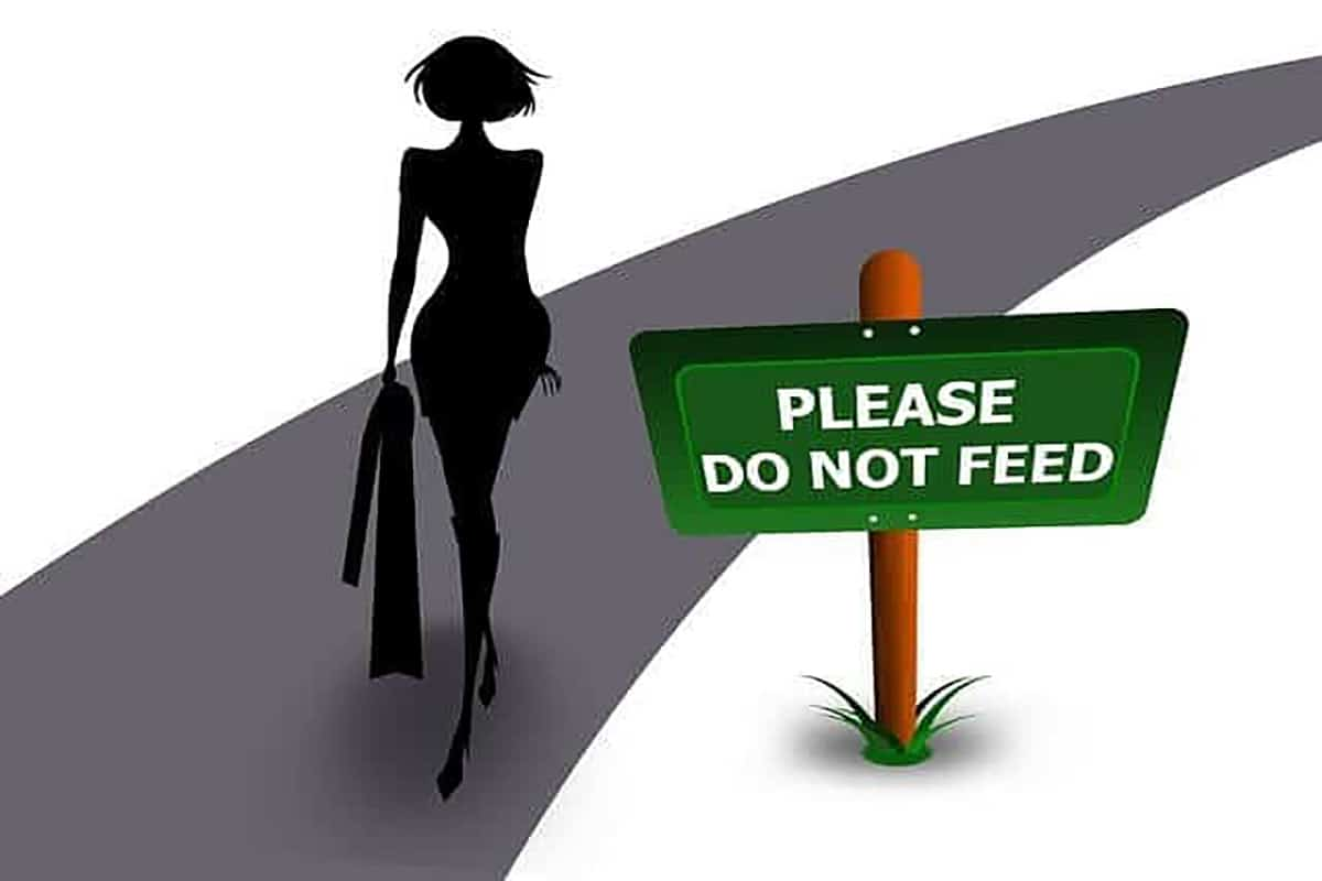 """Cartoon of a woman walking by a sign that reads """"do not feed"""" to demonstrate whether intermittent fasting for weight loss works."""