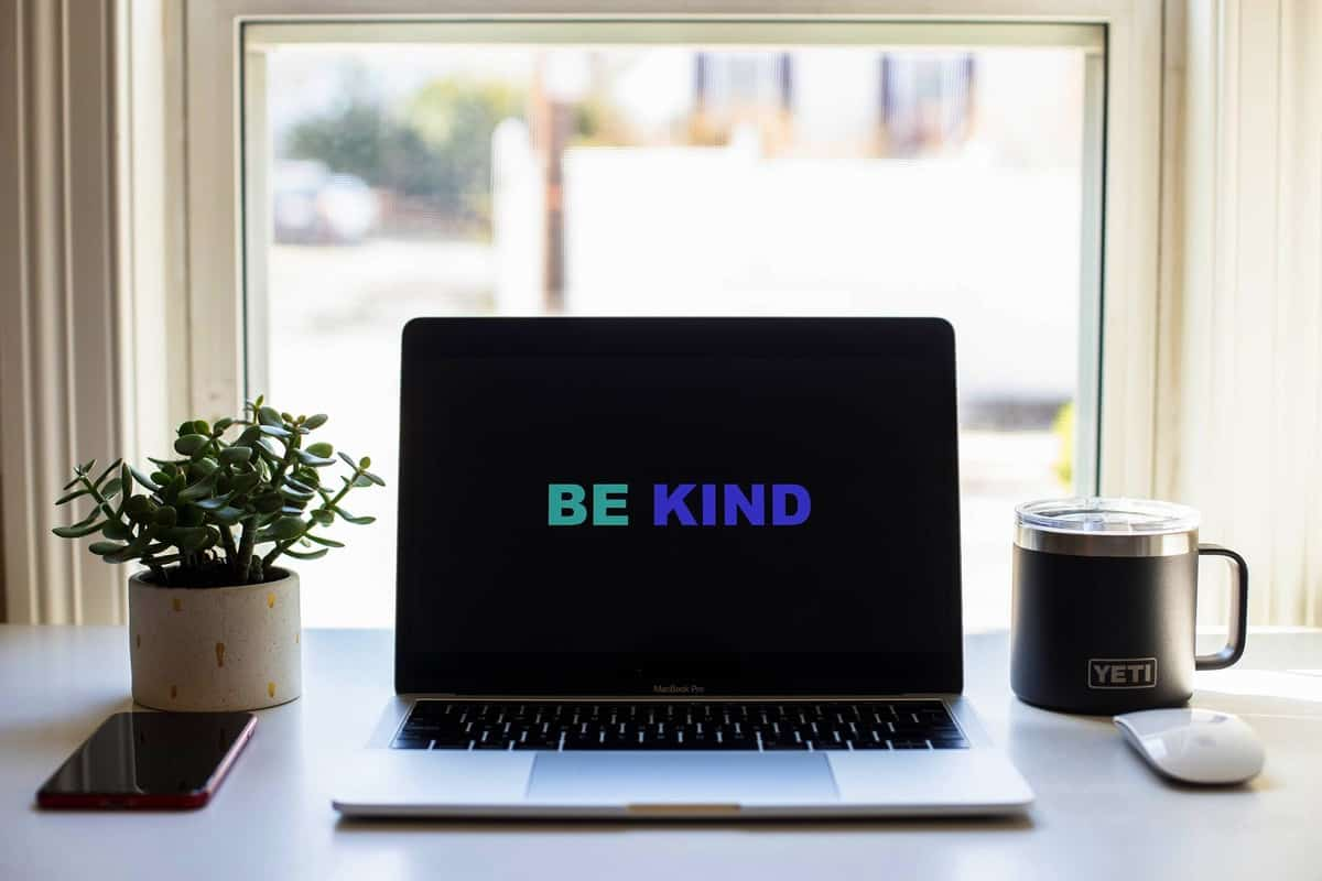 "A computer screen background that says ""be kind"" while dealing with quarantine weight gain."