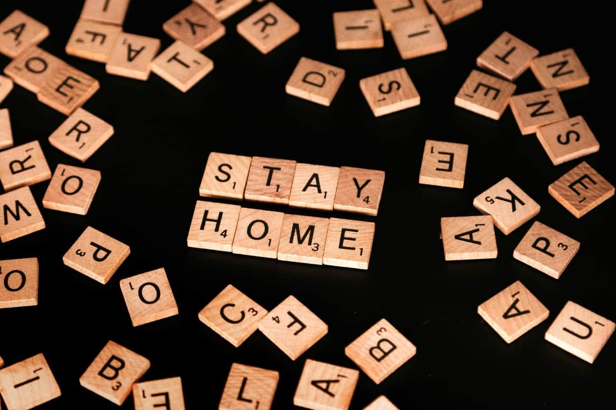 "Several scrabble letters pushed together to say ""stay home""."
