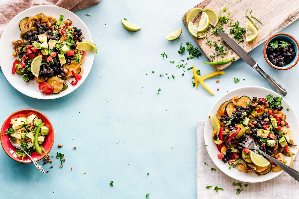 A variety of healthy bowls of food.