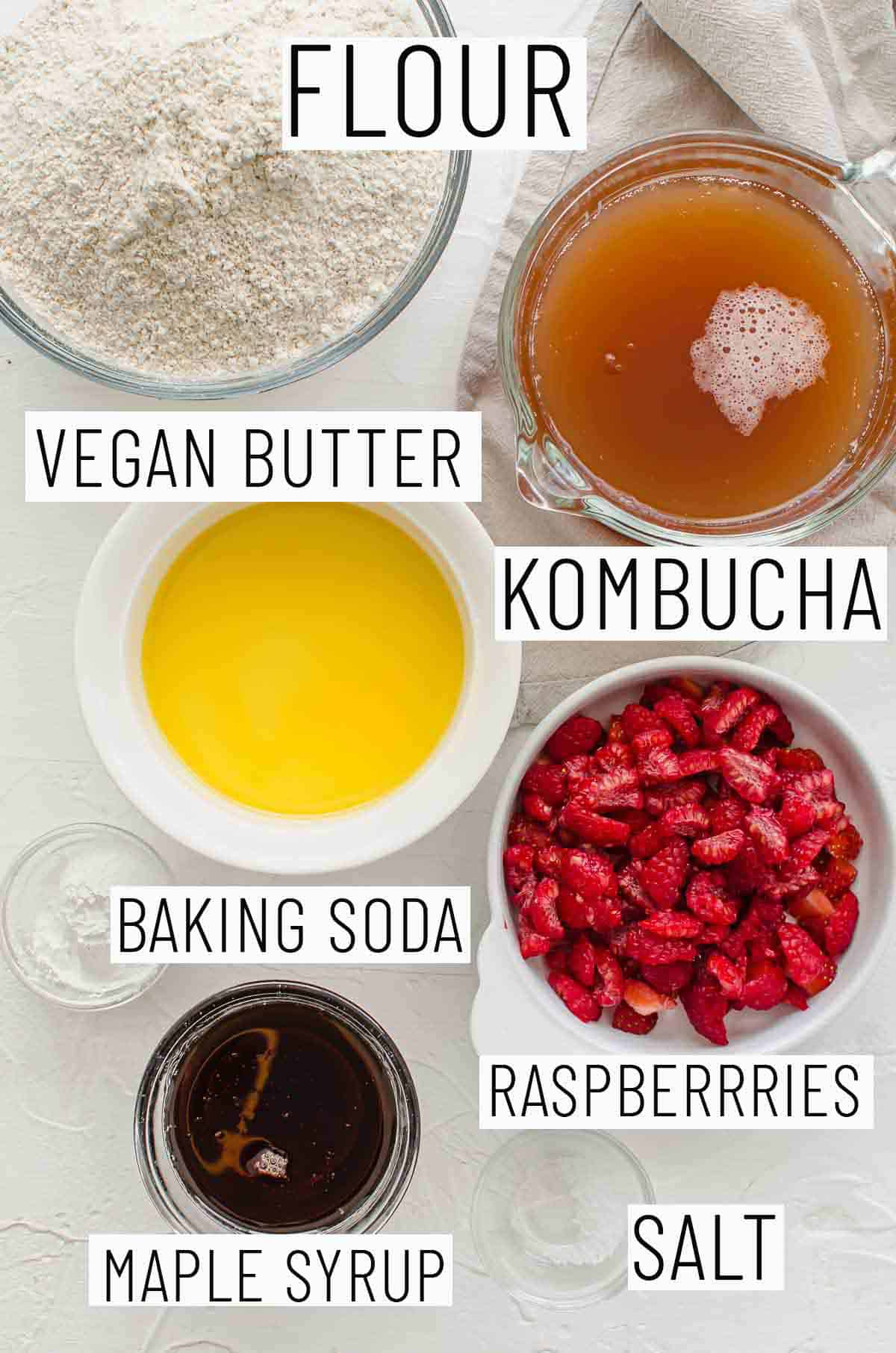 Flat lay images showing portioned recipe ingredients including kombucha, vegan butter, flour, raspberries, maple syrup, baking soda, and salt].