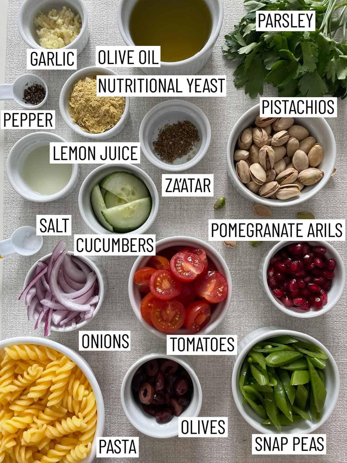 Ingredients needed to make pesto pasta salad.