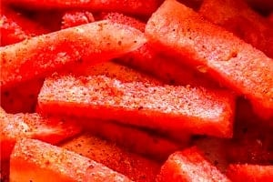 Pinterest graphic of close up of watermelon sticks.