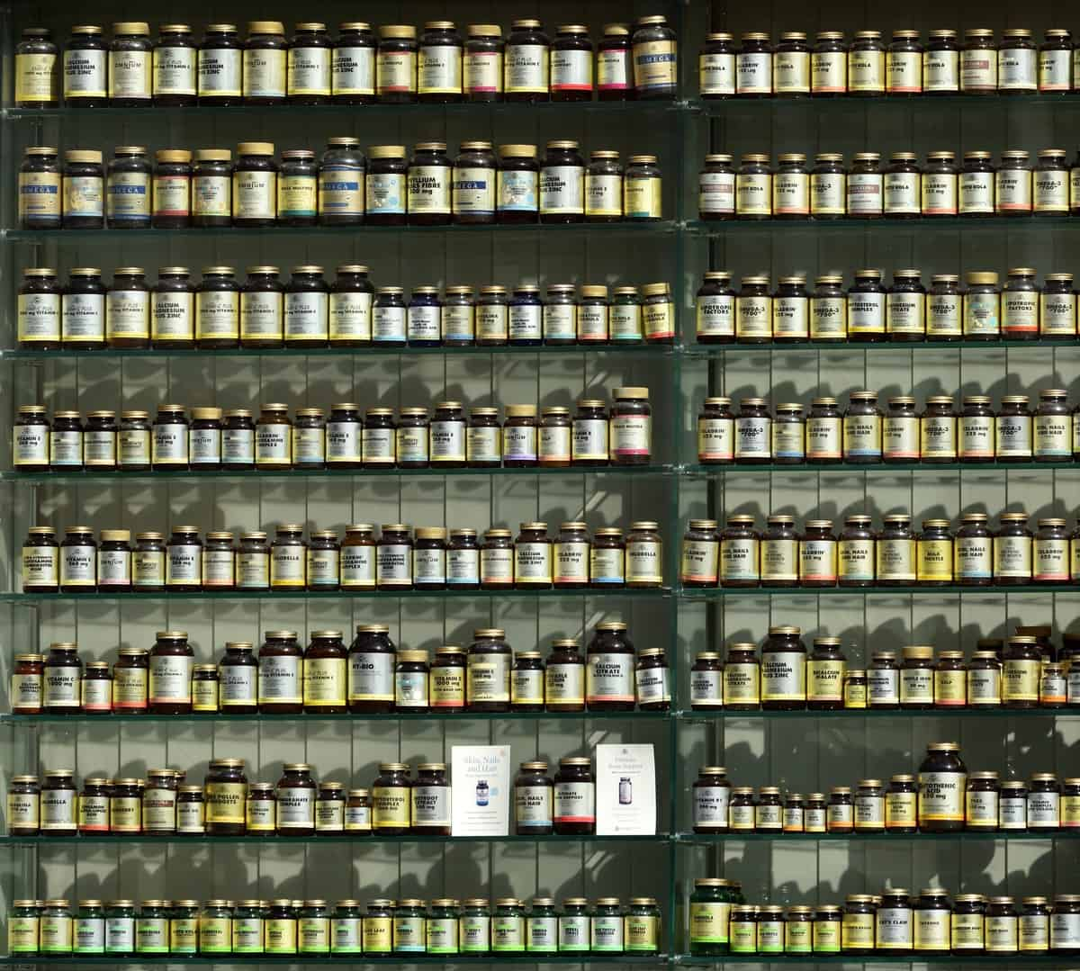 A wall of arbonne supplements.