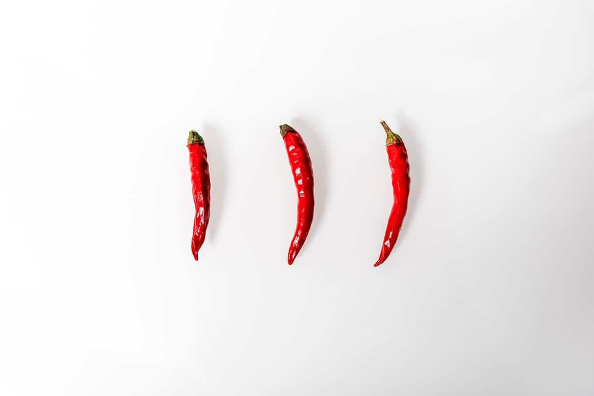 Three chili peppers to represent Arbonne ingredients.