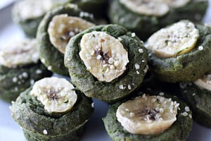 Pinterest graphic of a plate of spinach muffins.