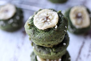 Pinterest graphic of a stack of spinach muffins with banana on top.