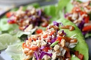 """Pinterest graphic of a plate of chicken lettuce wraps with the text overlay """"easy no-cook recipe chicken lettuce wraps."""""""