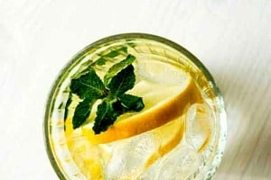 """Pinterest graphic of a glass of lemon water with text overlay """"why you should avoid goop detox diets."""""""