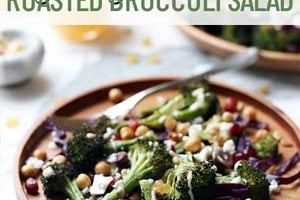 """Pinterest graphic of a plate of roasted broccoli salad on a wooden plate with text overlay """"vegan, gluten-free roasted broccoli salad."""""""