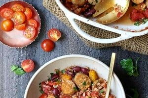 Pinterest graphic of a bowl of sausage casserole in front of a baking dish.