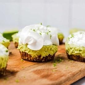 A mini vegan key lime pie on a serving board.