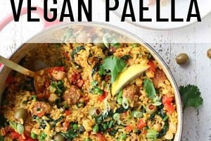 """Pinterest graphic of the overhead view of a pot of paella beside a plate with the text overlay """"vegan paella."""""""