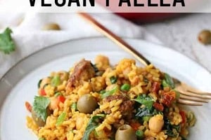 """Pinterest graphic of a plate of paella with the text overlay """"healthy protein-packed vegan paella."""""""