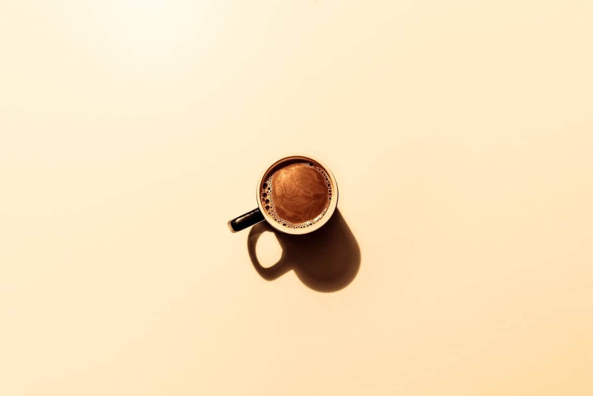 Birds eye view of a cup of coffee.