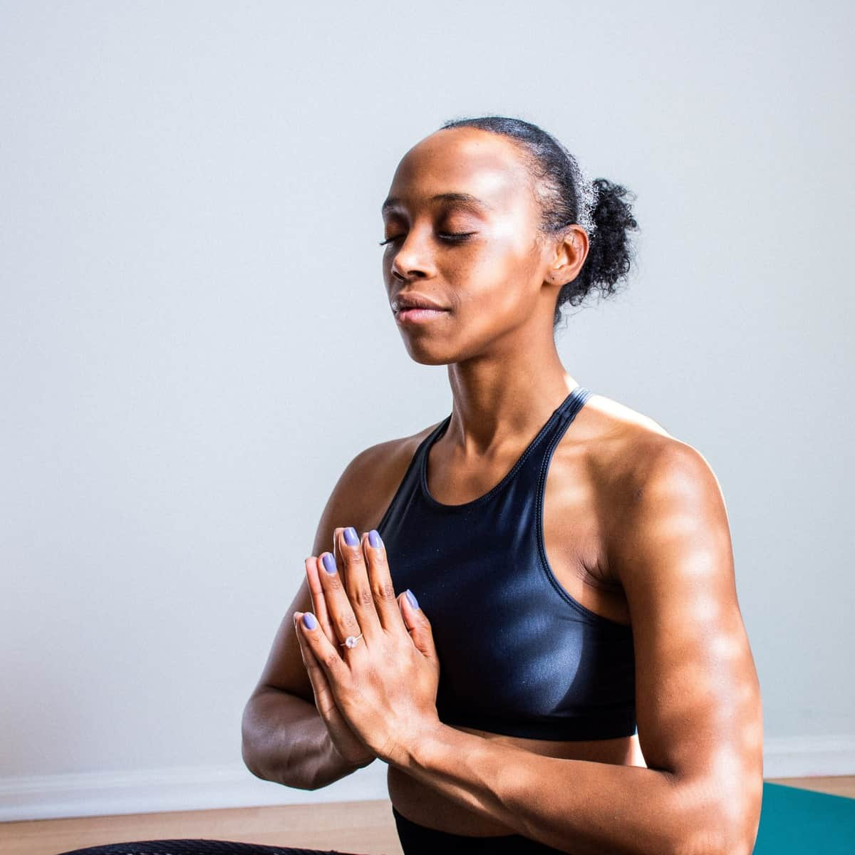 A woman meditating to manage cortisol levels.