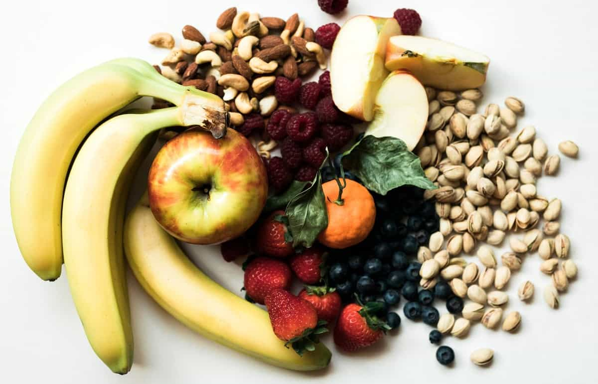 A spread of fruit, vegetables, and nuts.