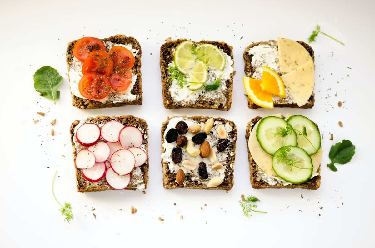 Six pieces of toast with a variety of toppings.