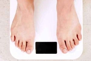 """Pinterest graphic of a person standing on a scale with the text """"cortisol, does it cause weight gain?"""""""