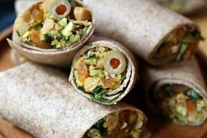 """Pinterest graphic of a plate with multiple wraps with the text overlay """"vegan Moroccan chickpea wrap."""""""