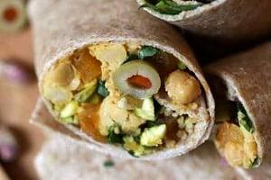 Pinterest graphic of vegan chickpea salad wraps cut in half.
