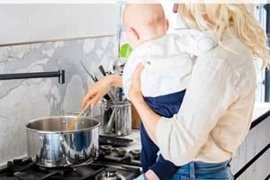 """Pinterest graphic of a woman holding a baby while stirring a pot with the text overlay """"mental health pregnancy, drugs, & anxiety."""""""