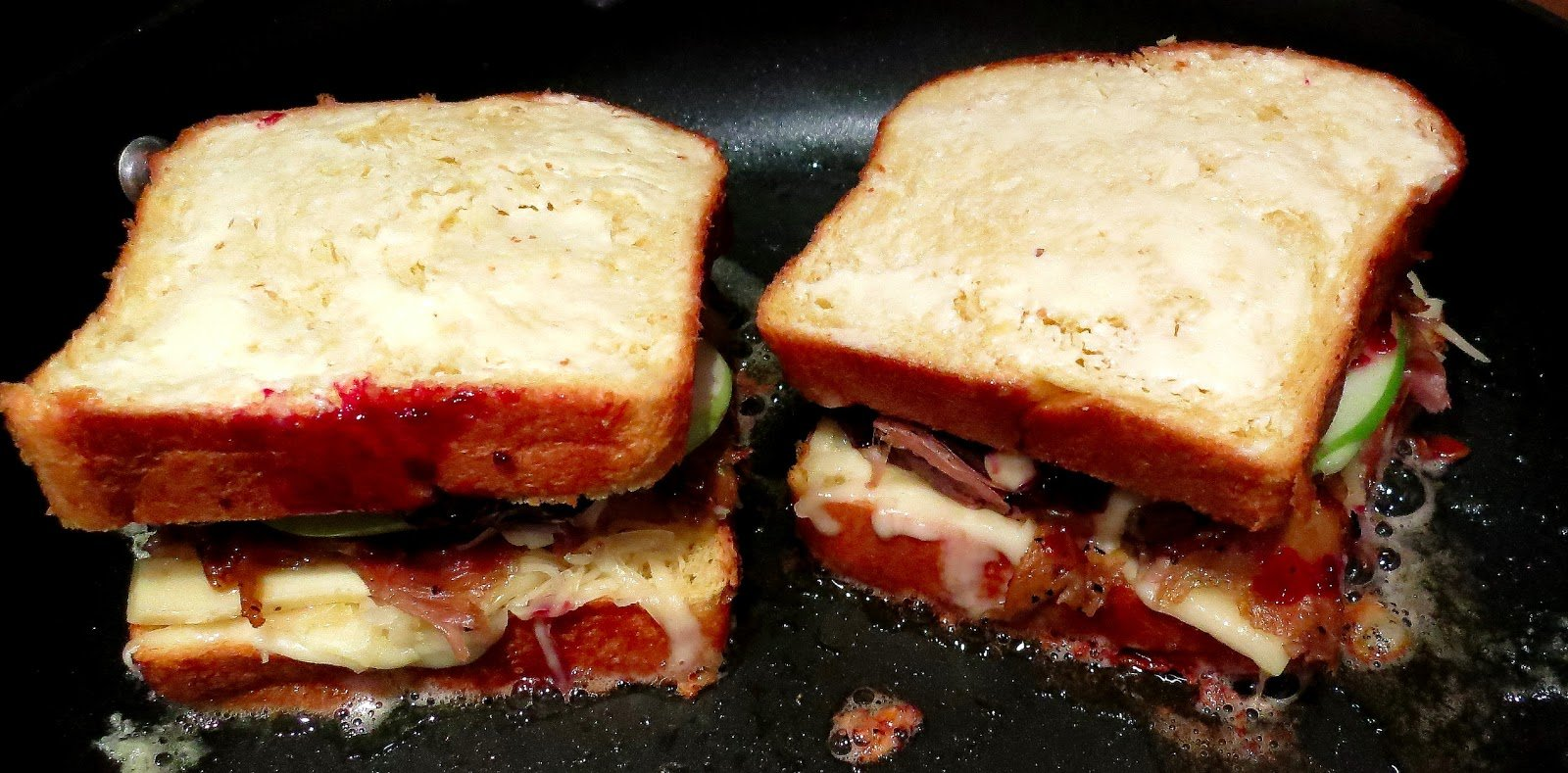A close up of a sandwich in a pan.