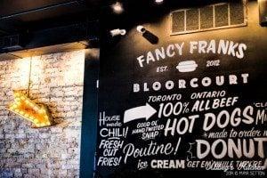 Fancy Frank's Gourmet Hot Dog's wall art and menu.