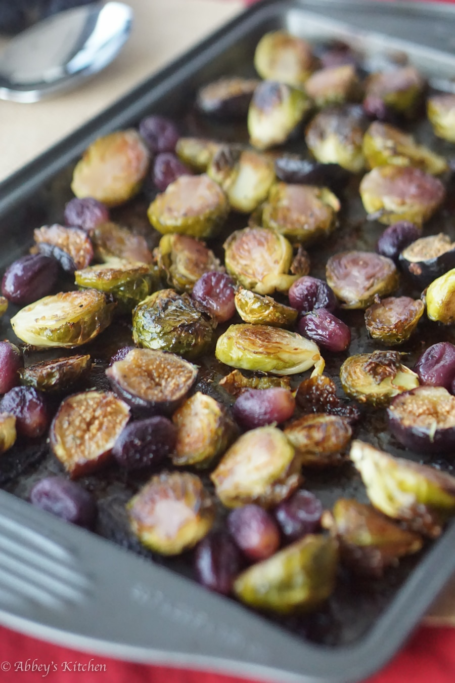 balsamic roasted brussel sprouts, figs, and grapes on a sheet pan