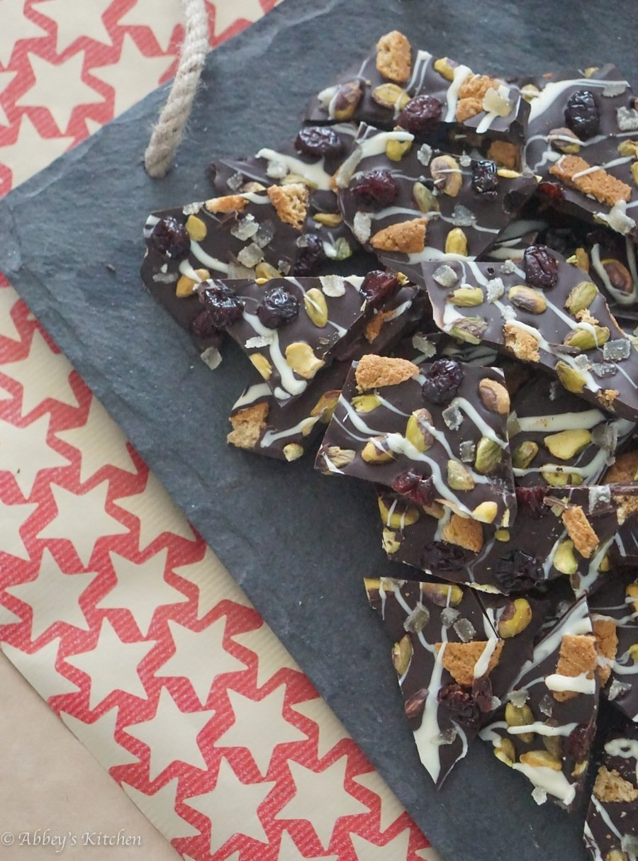 A serving of chocolate bark with cranberries and pistachios.